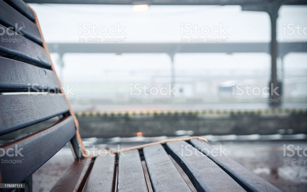 Empty bench in a train station stock photo