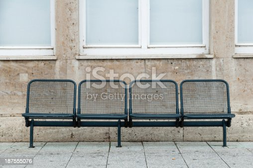 Empty bench in front of building facade in Friedrichshafen, Southern Germany