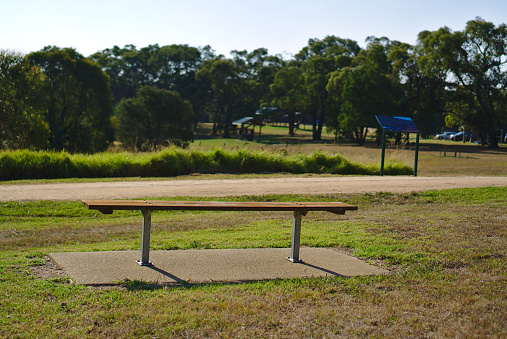 Empty bench in public park