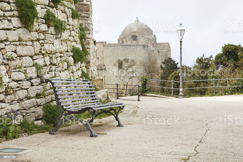 Empty bench on a street royalty-free stock photo