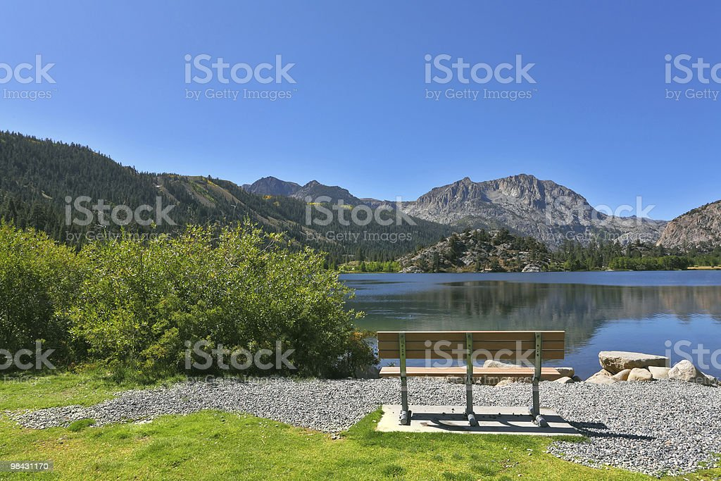 Empty bench on coast lake royalty-free stock photo