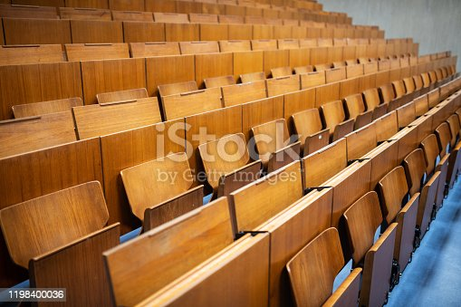 Germany: Empty wooden benches in an auditorium.