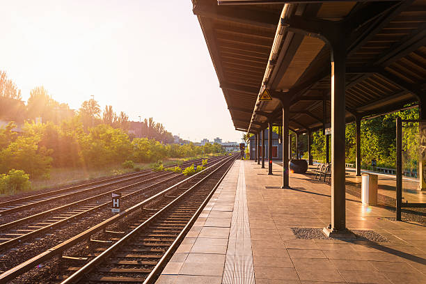 empty Berlin S-Bahn platform in warm summer afternoon Berlin S-Bahn in warm summer afternoon waiting on station subway platform stock pictures, royalty-free photos & images