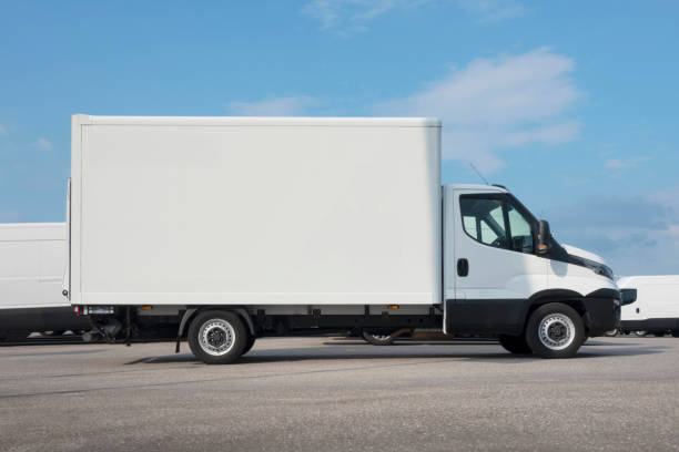 Empty big white delivery van parked with copy space stock photo