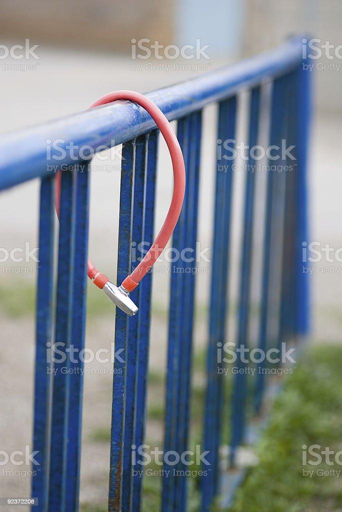 Empty bike rack with lone lock royalty-free stock photo