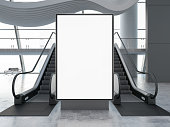 istock Empty Bilboard with Escalator in Airport 1264110500