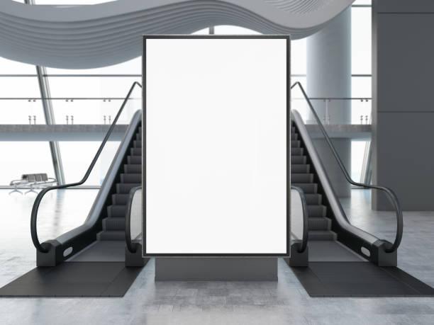 Empty Bilboard with Escalator in Airport stock photo