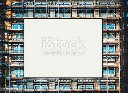 istock empty billboard canvas on building facade, advertisment mockup 1132083029