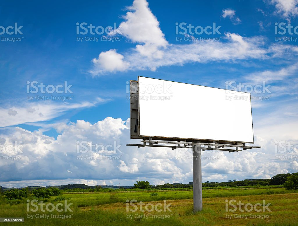 Empty billboard in front ofcloudy sky in a rural location stock photo