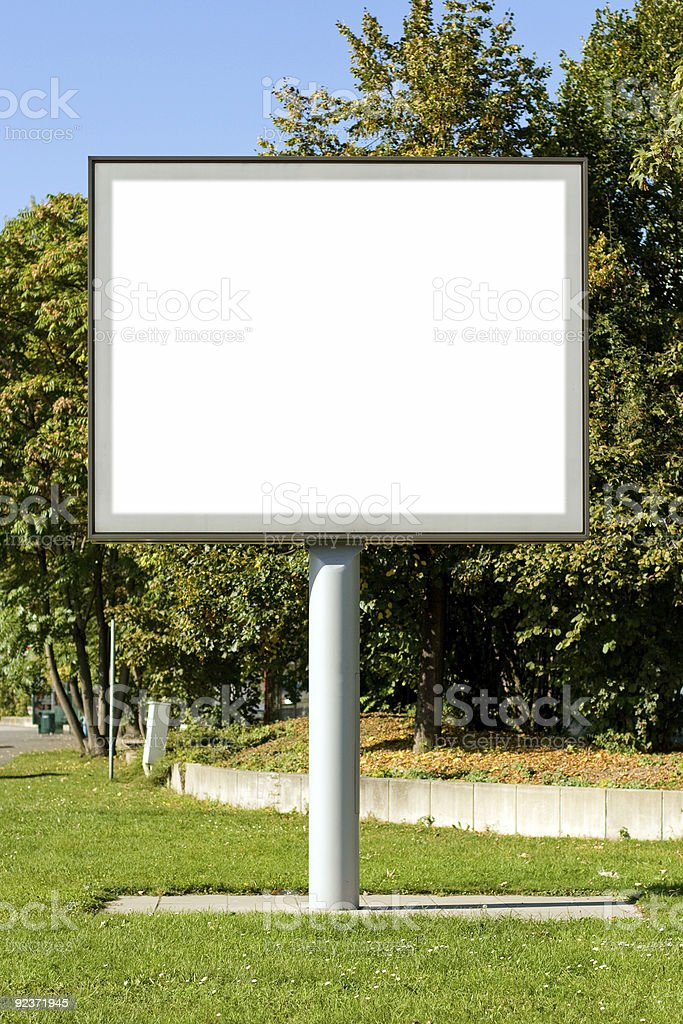 Empty Billboard infront of trees (w/ path) royalty-free stock photo