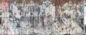 istock Empty billboard. Italian torn poster 1297785646