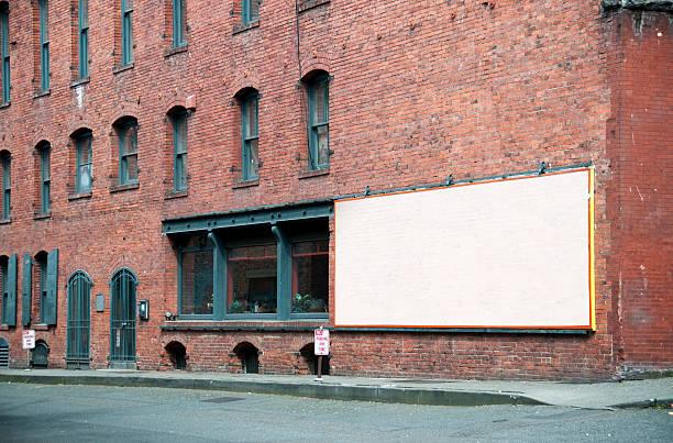 Empty Billboard on rustic brick building (Seattle, USA) stock photo