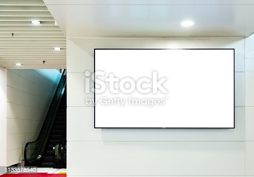 istock Empty billboard with escalator in subway station 1133578540