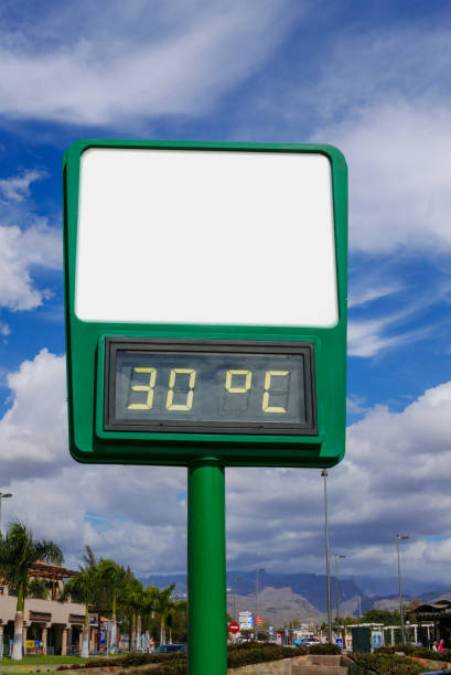 Empty billboard with thermometer which shows thirty degrees. stock photo