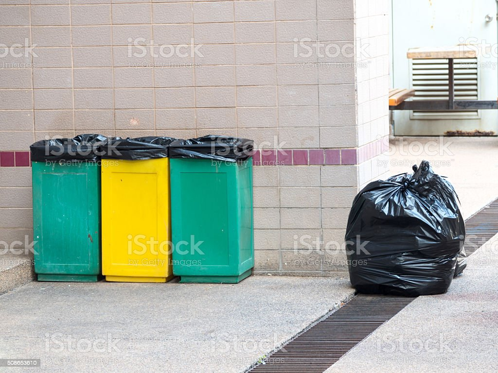 empty bins and black garbage bags stock photo