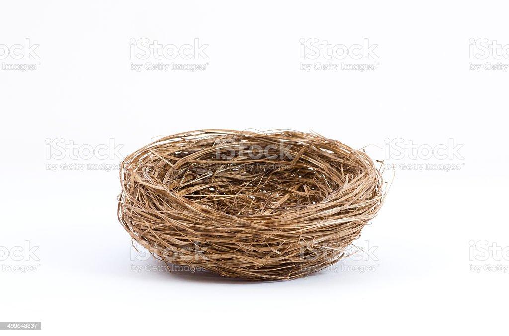 Empty bird nest on white background