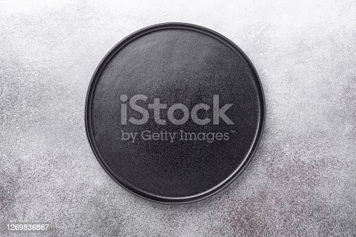 Empty black ceramic plate on stone background Copy space Top view - Image