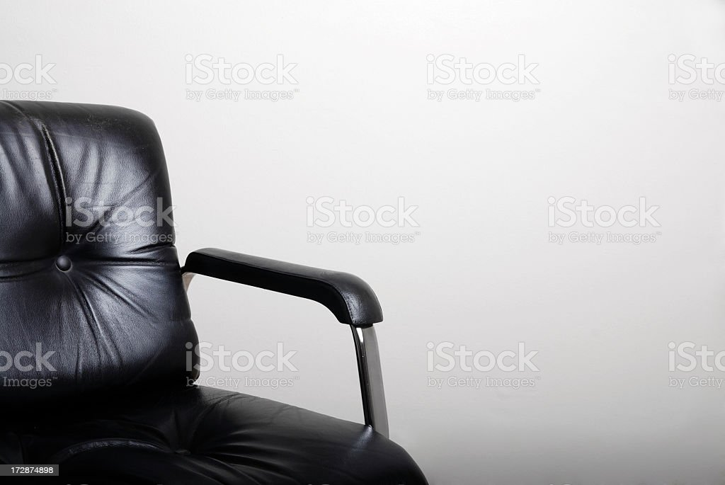 Empty black directors chair and a white wall stock photo