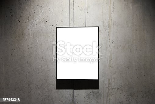 istock Empty black frame on concrete wall 587943048