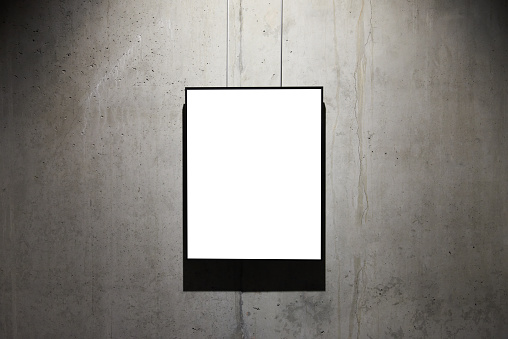 518847146 istock photo Empty black frame on concrete wall 587943048