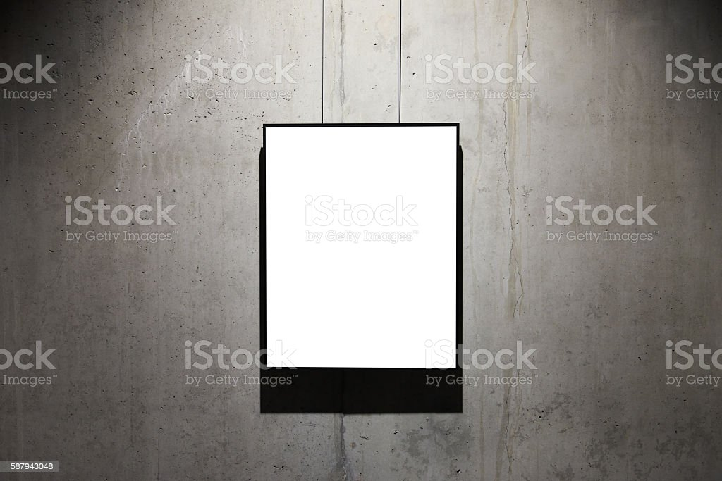 Empty black frame on concrete wall stock photo