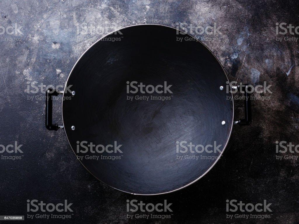 Empty black iron wok pan stock photo