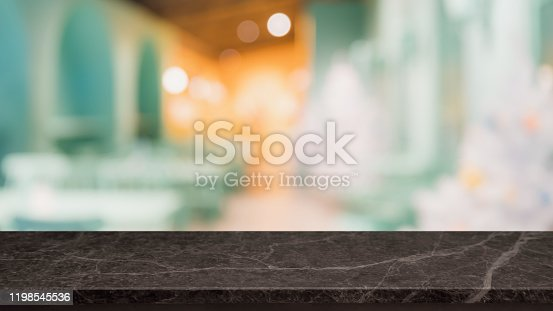 662984994 istock photo Empty black marble stone table top and blur glass window interior restaurant banner mock up abstract background - can used for display or montage your products. 1198545536