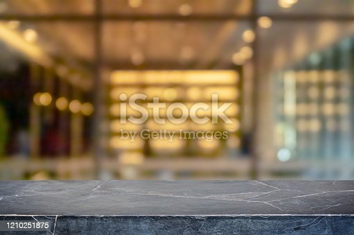 662984994 istock photo Empty black marble stone table top and blur glass window interior restaurant banner mock up abstract background - can used for display or montage your products. 1210251875
