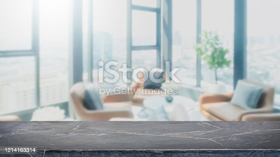 662984994 istock photo Empty black marble stone table top and blur glass window interior restaurant banner mock up abstract background - can used for display or montage your products. 1214163314