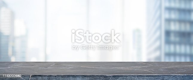 662984994 istock photo Empty black marble stone table top and blur glass window wall building banner mock up background - can used for display or montage your products. 1143202680