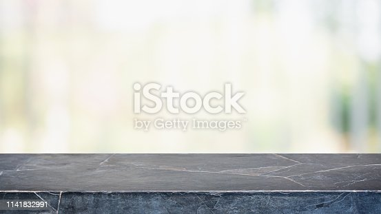 istock Empty black marble stone table top and blurred bokeh cafe and restaurent interior background - can used for display or montage your products. 1141832991