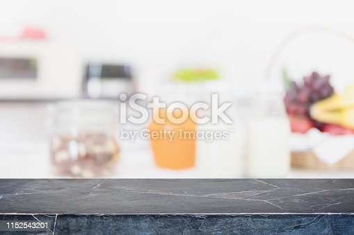 istock Empty black marble stone table top and blurred kitchen interior background - can used for display or montage your products. 1152543201