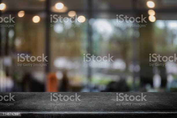 Empty black marble stone table top on abstract blurred restaurant and picture id1145742691?b=1&k=6&m=1145742691&s=612x612&h=fjbxxewfoxapc1k9k7b1ol ah3byu6tp3b8a xrva i=