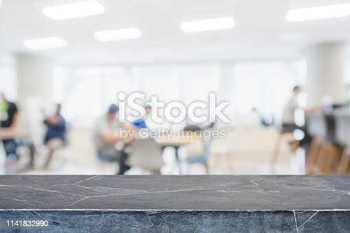 662984994 istock photo Empty black marble stone tabletop and blurred bokeh office interior space banner background - can used for display or montage your products. 1141832990