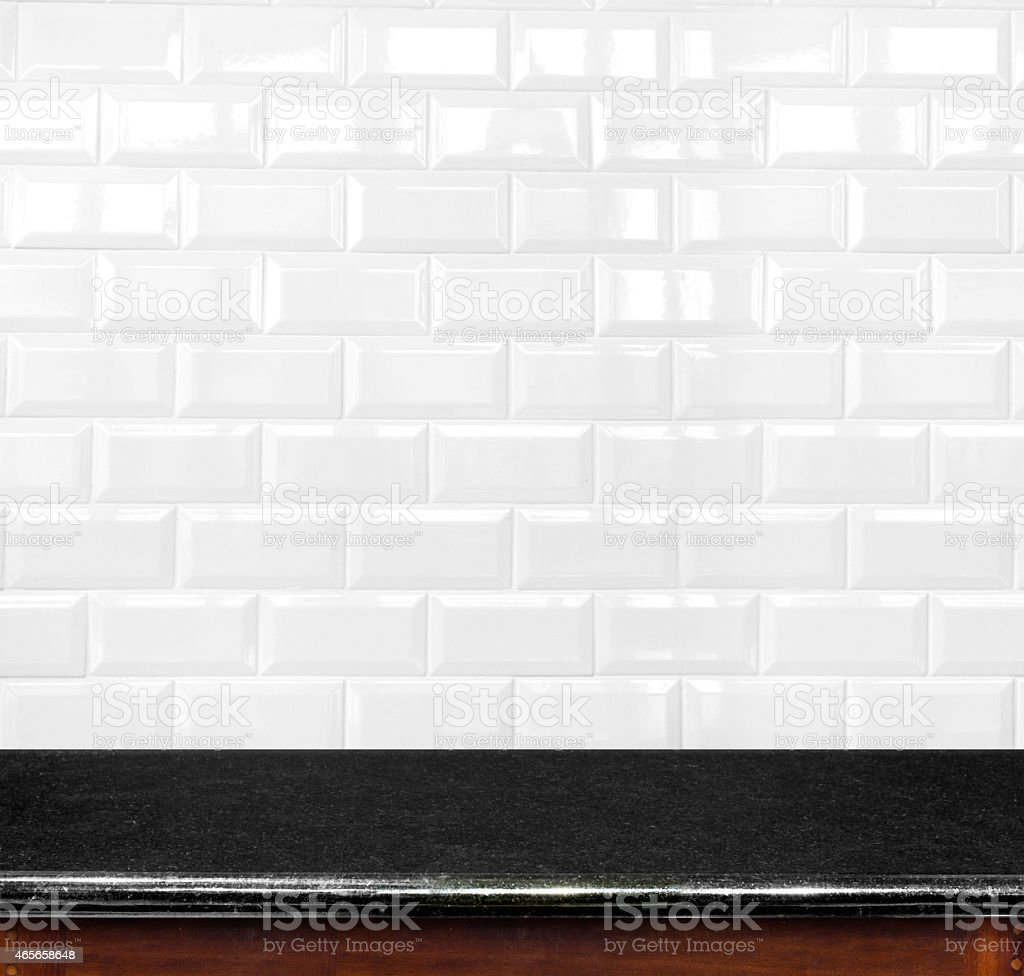 Empty black marble table and ceramic tile brick wall stock photo