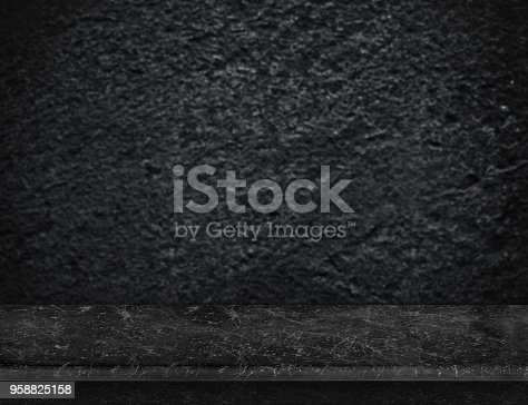 istock Empty black marble table top with blurred black rough stone wall,Mock up for display or montage of product 958825158