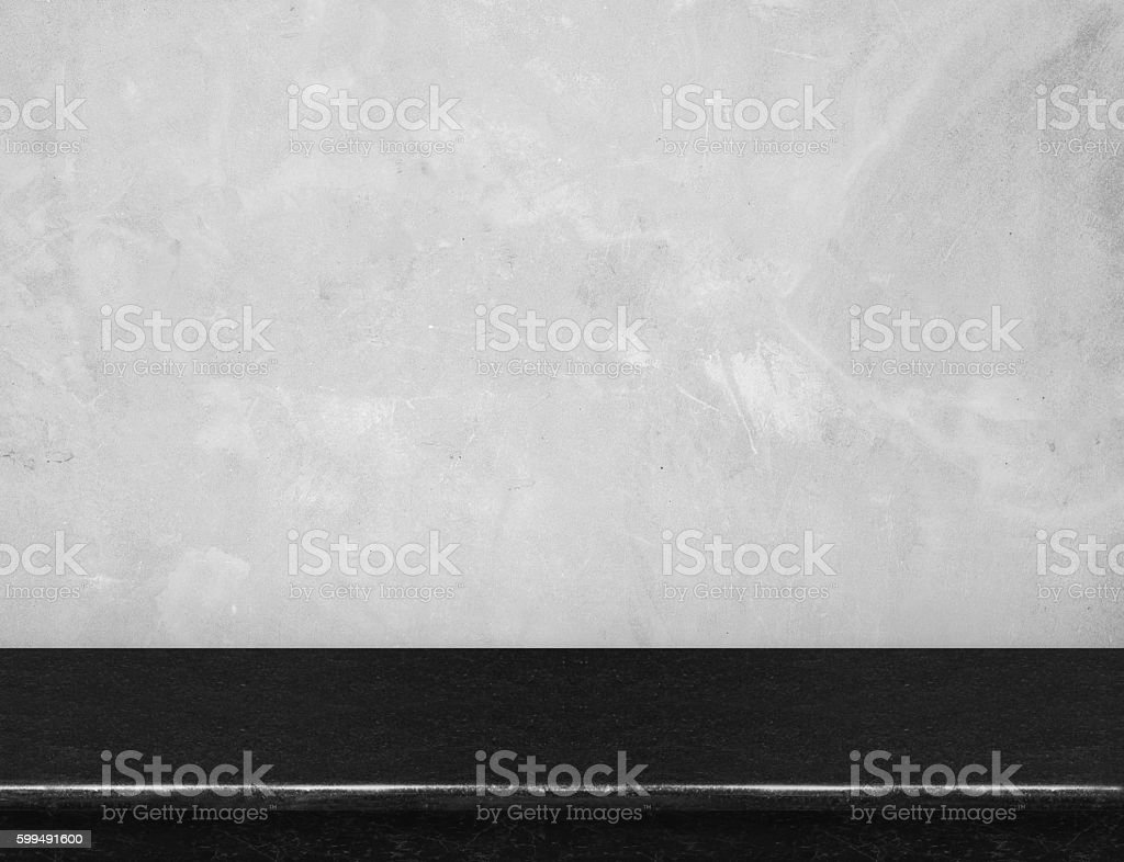 Empty black marble table top with grey concrete wall stock photo