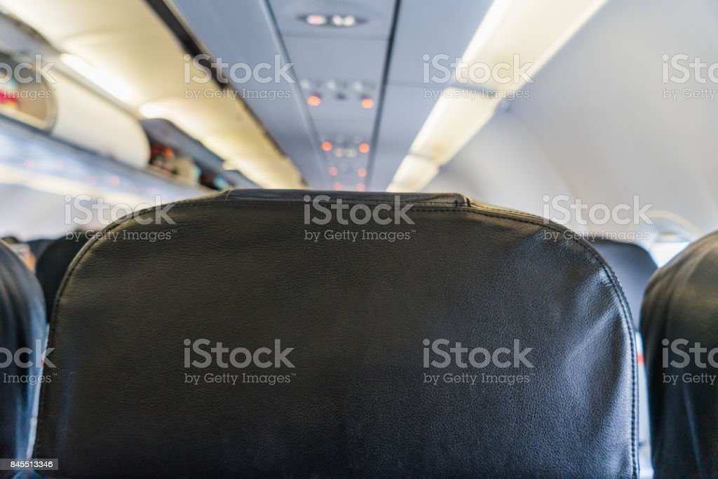 Empty Black seats inside Airplane, Back seat in Airplane stock photo