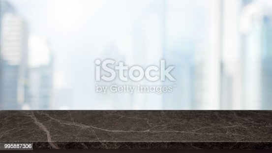 istock Empty black Stone table top and blur glass window wall building banner mock up background - can used for display or montage your products. 995887306