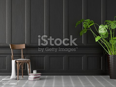 Empty black wooden wall panel with vase and plant