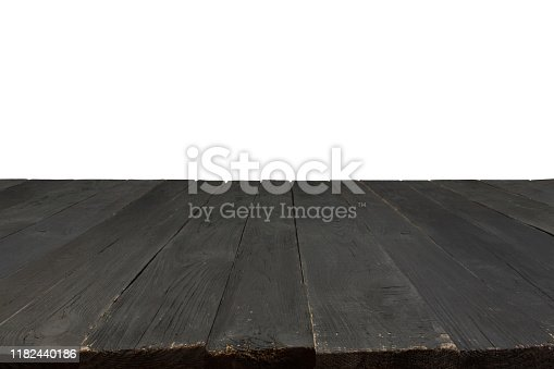 Empty black wooden table for product placement or montage with focus to the table top in the foreground, with white background