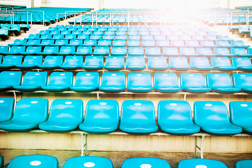 Empty blue arena seats with numbers in a stadium