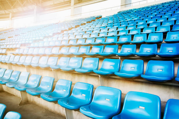 Empty blue arena seats with numbers in a stadium stock photo