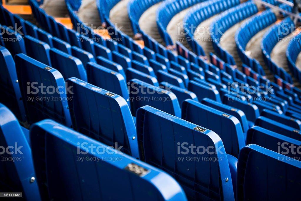 Empty blue bleachers in a stadium stock photo