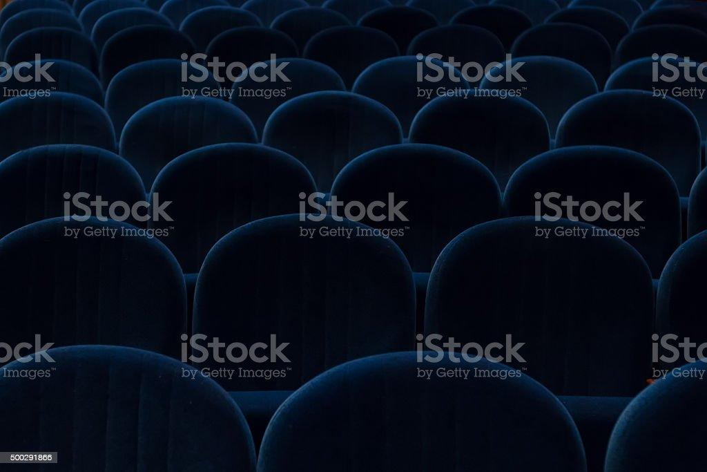 empty blue cinema or theater seats stock photo