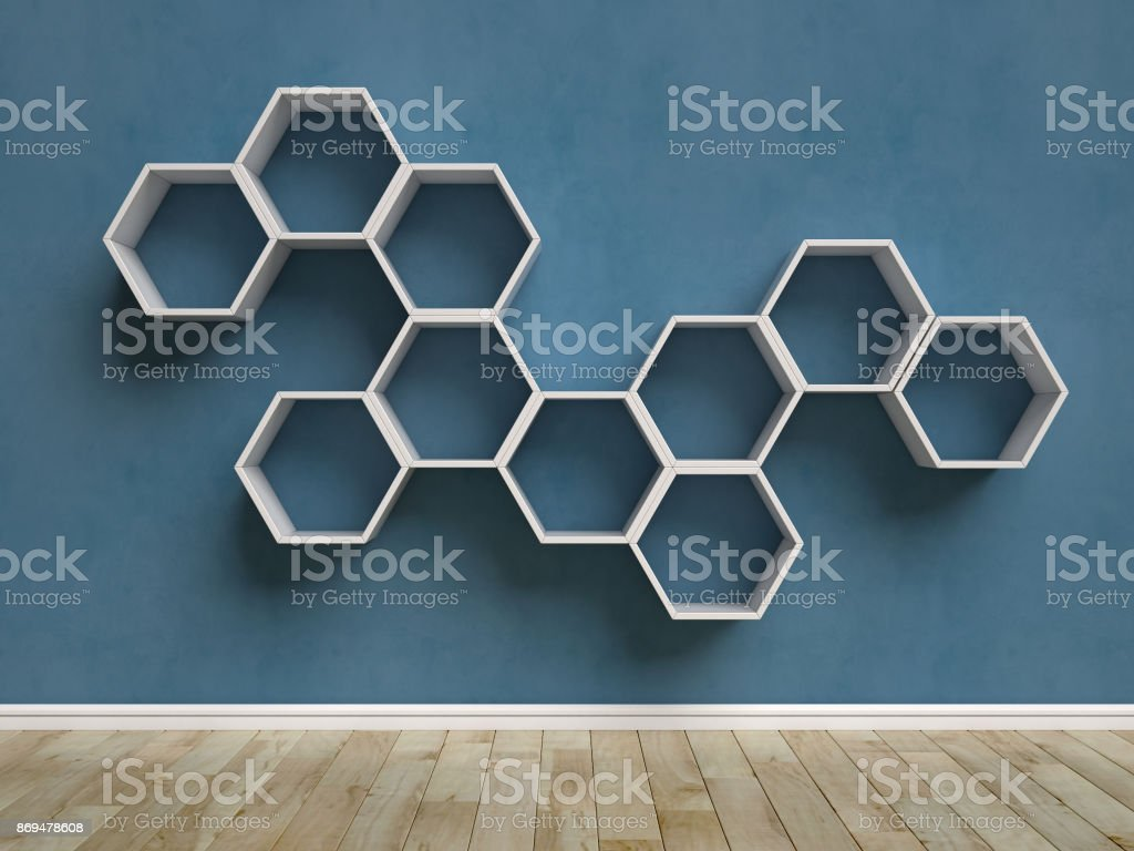 Empty blue interior with hexagon shelves on the wall stock photo
