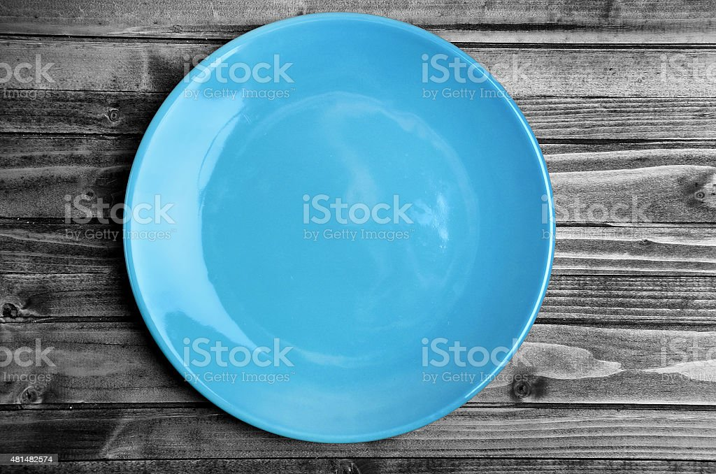 Empty blue plate on table stock photo