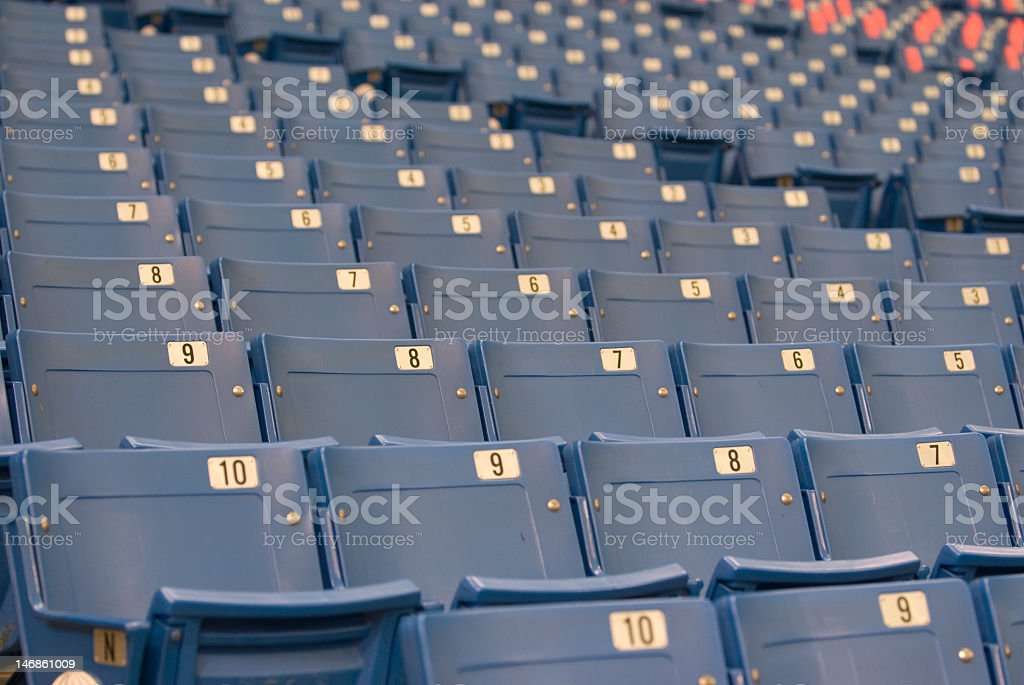 Empty Blue Stadium Seats with Numbers on Them royalty-free stock photo