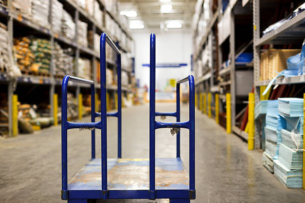 Empty blue trolley in warehouse stock photo