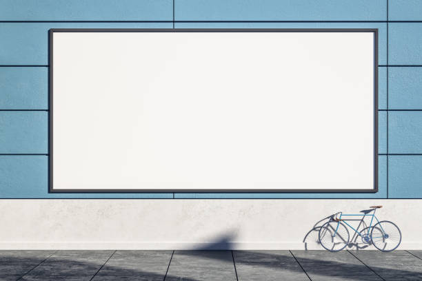 Empty blue wall with billboard Empty blue exterior wall with bicycle on street, empty billboard and sunlight. Mock  up, 3D Rendering billboard stock pictures, royalty-free photos & images